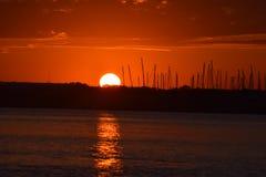 Por do sol na doca Imagens de Stock