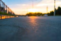 Por do sol na estrada Imagens de Stock