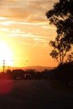 Por do sol na estrada Imagens de Stock Royalty Free