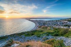 Por do sol na ilha de Portland em Dorset Fotos de Stock Royalty Free