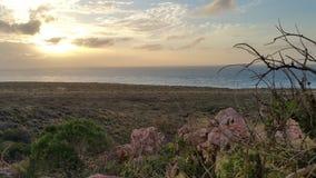 Por do sol na montanha do farol Foto de Stock
