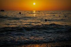 Por do sol na praia Foto de Stock