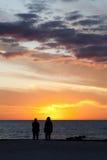 Por do sol na praia imagens de stock royalty free