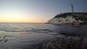 Por do sol na praia de Achziv vídeos de arquivo