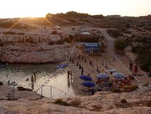 Por do sol na praia de Cala Francese Foto de Stock