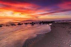 Por do sol na praia de Casperson imagem de stock