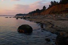 Por do sol na praia de Knud em Dinamarca Imagem de Stock