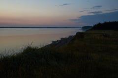 Por do sol na praia de Knud em Dinamarca Fotografia de Stock