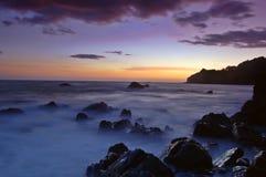 Por do sol na praia de Muir Foto de Stock