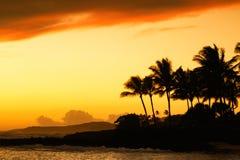 Por do sol na praia de Poipu Imagens de Stock Royalty Free