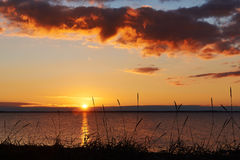 Por do sol na praia de Vadum em Salling, Dinamarca - série Foto de Stock Royalty Free