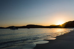 Por do sol na praia de Whitehaven Imagens de Stock
