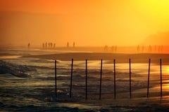 Por do sol na praia dois de Salalah fotos de stock royalty free