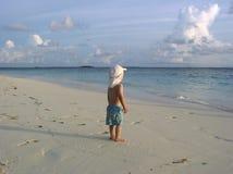 Por do sol na praia dos bandos Imagem de Stock