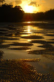 Por do sol na praia famosa do por do sol imagens de stock royalty free