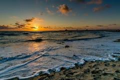 Por do sol na praia imperial, CA foto de stock