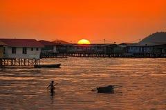Por do sol na vila da água Imagens de Stock