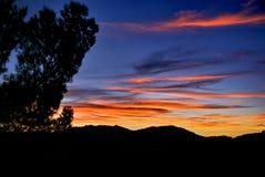 Por do sol nas montanhas Fotografia de Stock