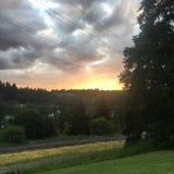 Por do sol nebuloso Foto de Stock Royalty Free