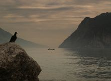 Por do sol nebuloso do lago Imagem de Stock