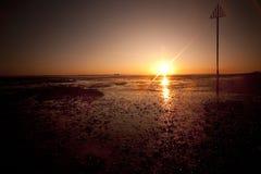 Por do sol no console do mersea no essex Foto de Stock Royalty Free