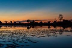 Por do sol no delta de Okavango imagem de stock royalty free