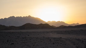 Por do sol no deserto Foto de Stock Royalty Free
