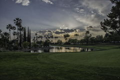 Por do sol no fairway Imagens de Stock Royalty Free