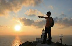 Por do sol no farol de Akrotiri, Santorini Imagens de Stock