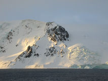 Por do sol no gelo Fotos de Stock Royalty Free