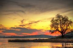 Por do sol no lago em Ireland Imagens de Stock