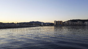 Por do sol no período de Malaga da praia de Malagueta Fotos de Stock Royalty Free