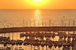 Por do sol no porto de Telavive, Israel Imagens de Stock Royalty Free
