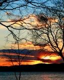 Por do sol no rio Imagem de Stock