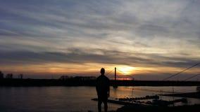 Por do sol no rio Fotografia de Stock