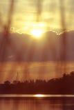 Por do sol no rio Fotos de Stock Royalty Free