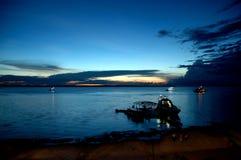 Por do sol no rio preto Imagem de Stock