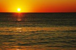 Por do sol no seaa Foto de Stock
