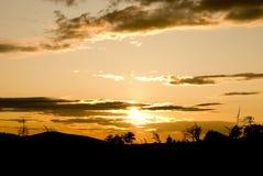 Por do sol no villige Foto de Stock