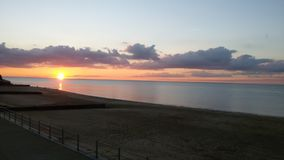 Por do sol no westgate no mar fotografia de stock