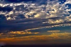 Por do sol-nuvens Imagem de Stock