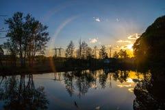 Por do sol pelo rio Imagem de Stock