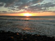 Por do sol Playa Rompeolas Aquadillia Porto Rico imagem de stock royalty free