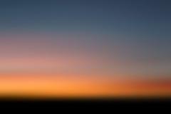 Por do sol que desperta Imagem de Stock
