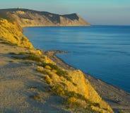 Por do sol, rochas e mar Fotos de Stock Royalty Free
