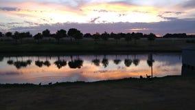 Por do sol rochoso do lago Foto de Stock Royalty Free