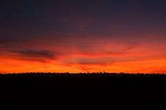 Por do sol roxo de Argentina do vermelho alaranjado Imagens de Stock
