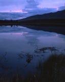 Por do sol roxo do colorsof imagem de stock
