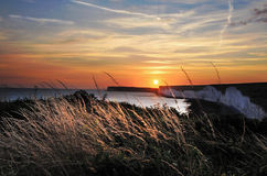 Por do sol sobre Birling Gap imagem de stock