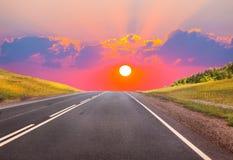 Por do sol sobre a estrada do país Imagem de Stock Royalty Free